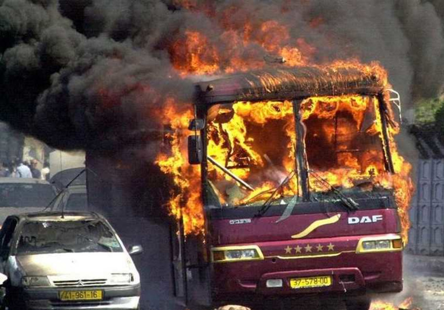 A bus burns where a car bomb exploded at Beit Lid junction near Netanya, September 9, 2001