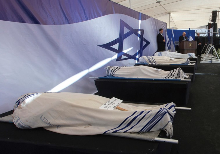 The covered bodies of Paris kosher supermarket terror attack victims.