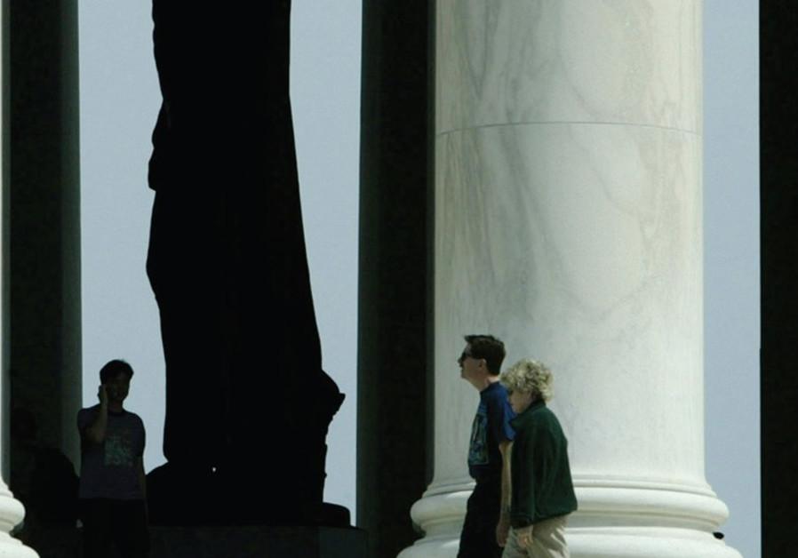 TOURISTS STROLL around the memorial to former US president Thomas Jefferson in Washington.