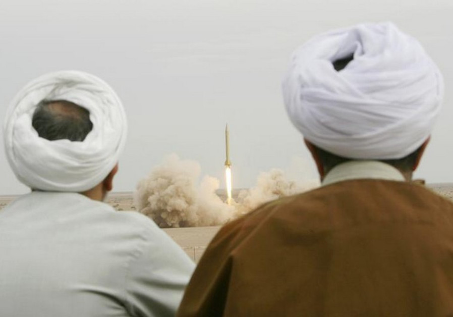 Iranian clerics watch the firing of a Shahab-3 missile during a war game in a desert near Qom
