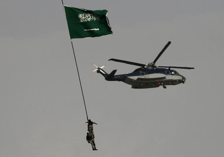 Members of the Saudi security forces take part in a military parade in preparation for the Haj