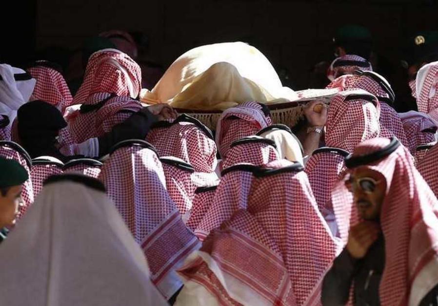 The body of Saudi King Abdullah bin Abdul Aziz is carried during his funeral in Riyadh