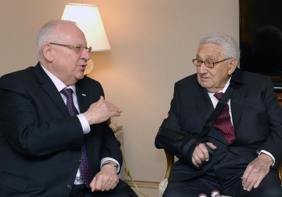 President Reuven Rivlin (L) meets former secretary of state Henry Kissinger in New York