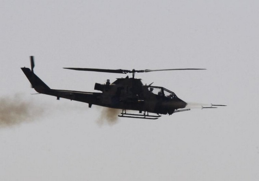 A combat Cobra helicopter fires during the EFES-2010 military exercise in Izmir