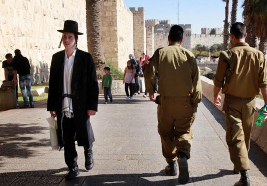 Haredi man and IDF soldiers in Jerusalem.