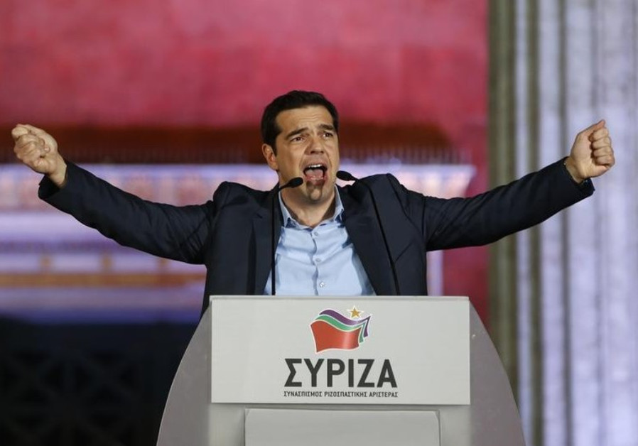 The head of radical leftist Syriza party Alexis Tsipras speaks to supporters