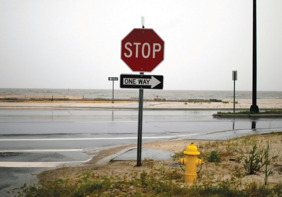 A STOP sign at a crossroads