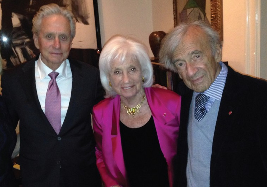 MICHAEL DOUGLAS (L) and Elie and Marion Wiesel