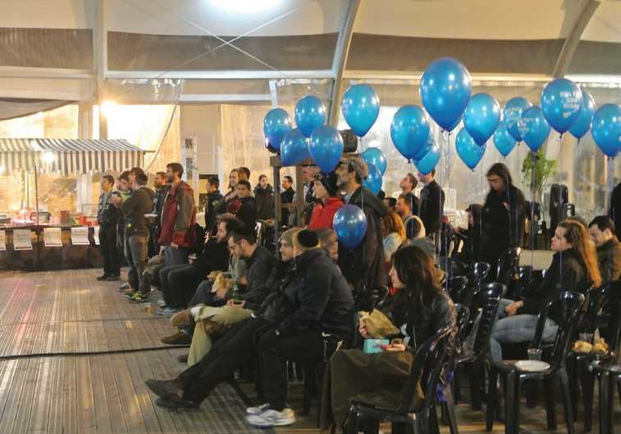 EXCITED FOOTBALL fans gather in Jerusalem's First Station to take in Sunday's late-night Super Bowl.