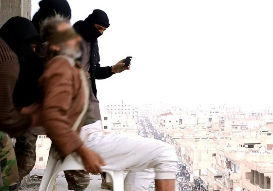 Masked Islamic State terrorists throw man accused of being gay off of a high-rise building