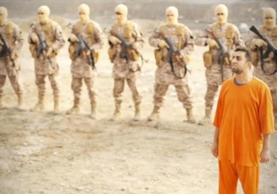 A man purported to be Islamic State captive Jordanian pilot Muath al-Kasaesbeh (in orange jumpsuit)