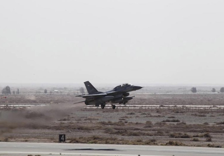 A Royal Jordanian Air Force plane takes off from an air base to strike the Islamic State
