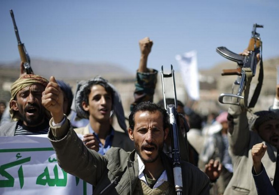 Followers of the Houthi movement shout slogans during a gathering to show support to the movement
