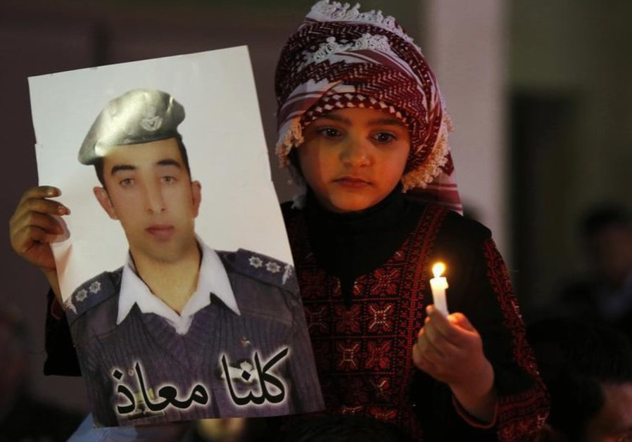 A Jordanian girl holds a poster of pilot Muath al-Kasaesbeh, who was killed in ISIS captivity