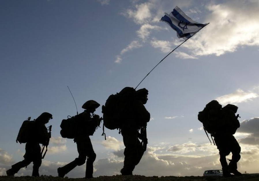 Israeli soldiers cross the Gaza border back to Israel early morning after a combat mission in Gaza