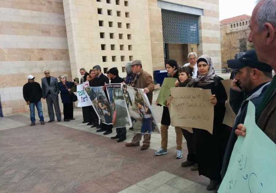 PROTESTERS GATHER in Jerusalem's Safra Square Sunday morning to protest the arrest of Arab children