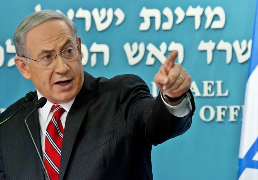 Prime Minister Benjamin Netanyahu gestures during a news conference at his office in Jerusalem