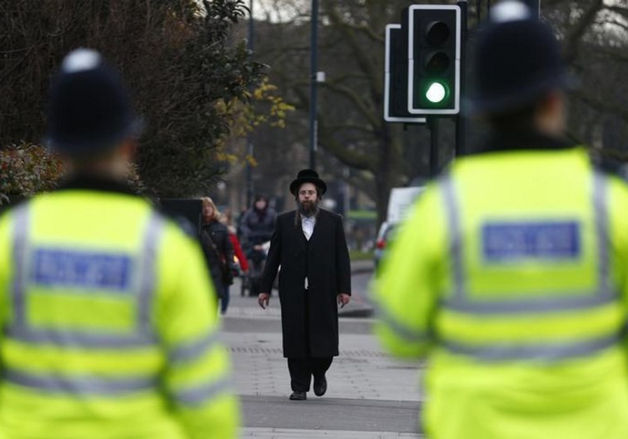 A member of the Jewish community walks in north London