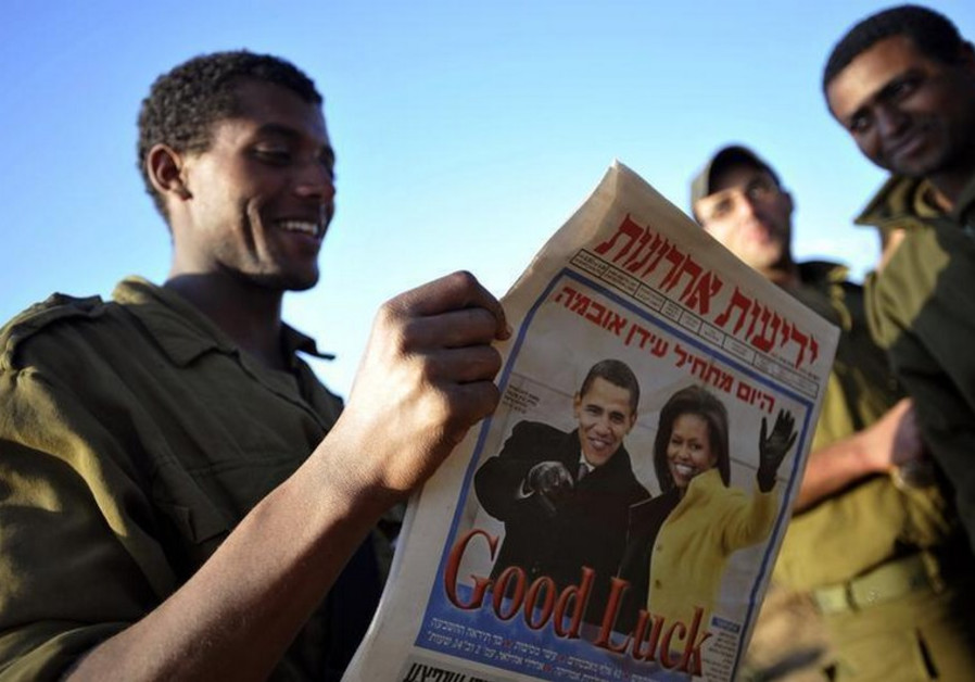 An Israeli soldier reads Yediot Aharonot