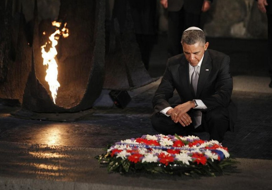 U.S. President Barack Obama pauses for a moment as he lays a wreath at Yad Vashem