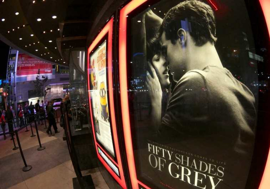 """A film poster for """"Fifty Shades of Grey"""" is pictured at Regal Theater in Los Angeles"""