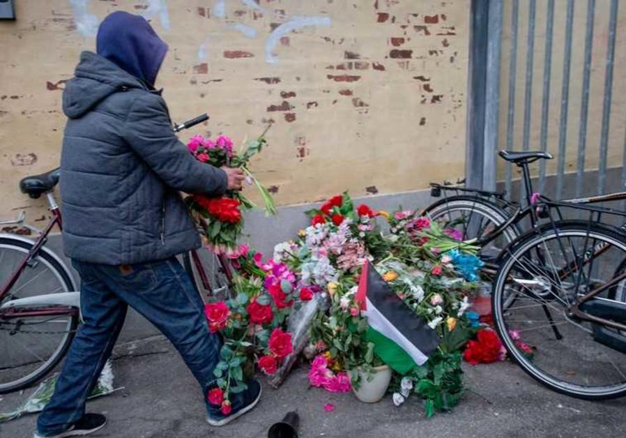 Flowers at site where gunman, Omar Abdel Hamid El-Hussein was killed in Norrebro district, Copenhage