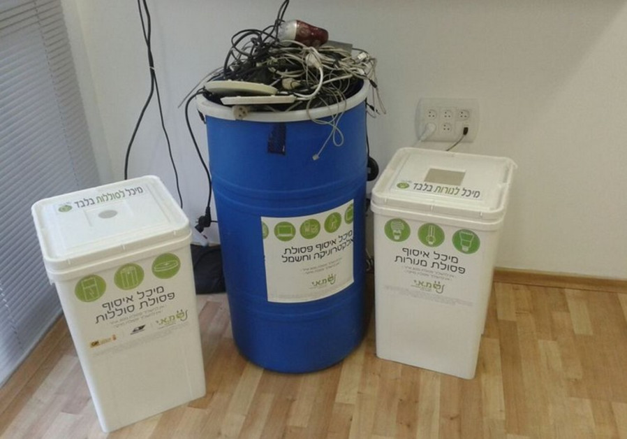 bBarrels of electrical plugs and products collected by e-waste recycling company M.A.I.