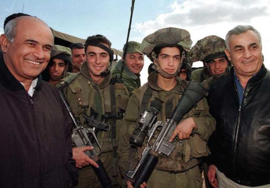 Yitzhak Mordechai and Avigdor Kahalani visit Israeli troops near border with Lebanon in 1999.
