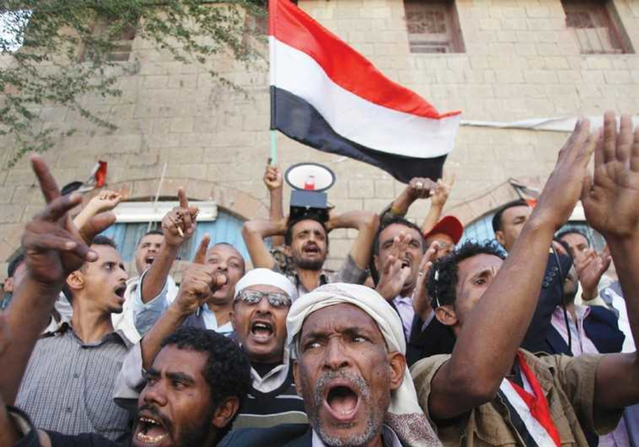 PROTESTERS SHOUT slogans against the Shi'ite Muslim Houthi movement, in Taiz.