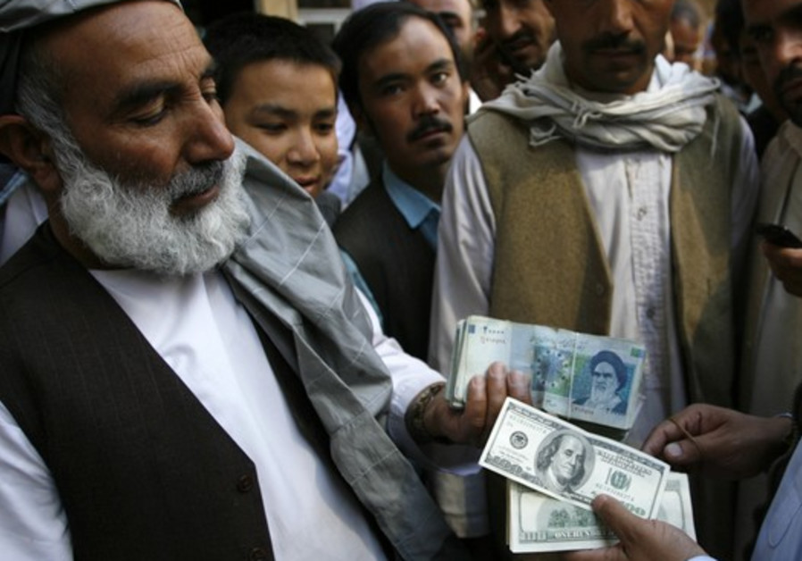 Afghan money lenders trade Iranian rial for dollars