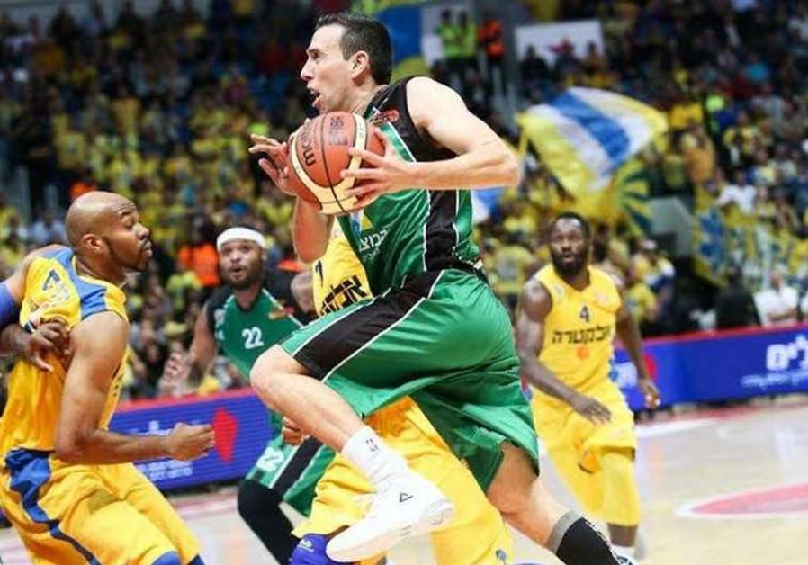 Maccabi Haifa guard Moran Roth drives to the basket