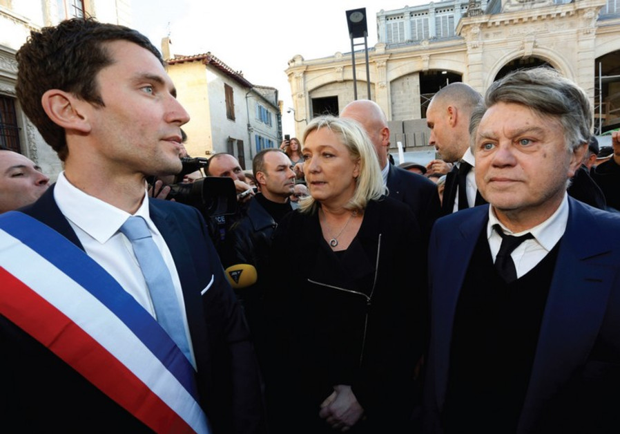 NATIONAL FRONT leader Marine Le Pen attends a gathering to pay tribute to the 'Charlie Hebdo'