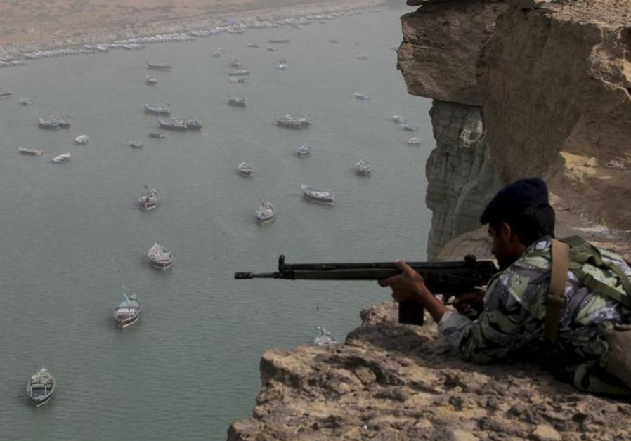 Iranian military personnel participate in war games in an unknown location near the Strait of Hormuz