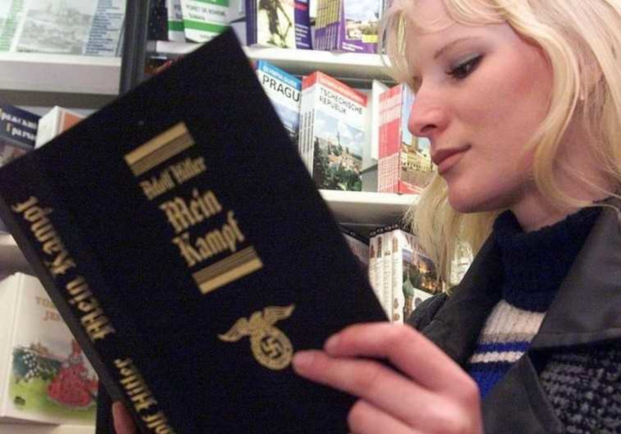 A young Czech woman reads a copy of Hitler's manifesto Mein Kampf in a central Prague's bookstore