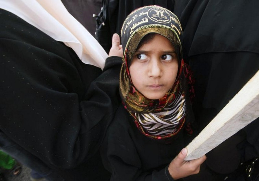 A Palestinian girl attends a rally organized by the Islamic Jihad movement in Gaza City
