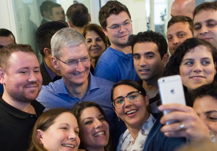 Tim Cook, Apple's CEO, meeting the employees at the new Apple office in Herzliya