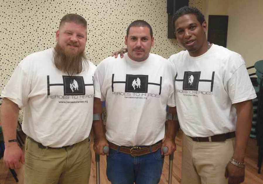 IN TEL AVIV yesterday are, from left, former US soldier Corey Gibson, former IDF border policeman Mo