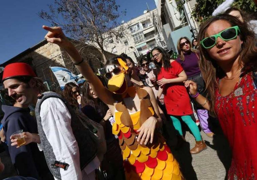 Jerusalemites revel during Purim festivities in the downtown neighborhood of Nahlaot