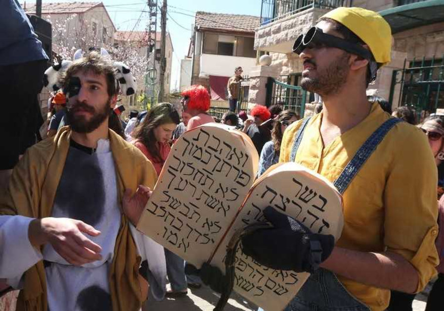 Jerusalemites revel during Purim festivities in the downtown neighborhood of Nahlaot