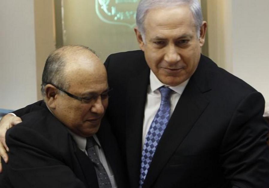 Prime Minister Benjamin Netanyahu (R) embraces former Mossad chief Meir Dagan in 2011