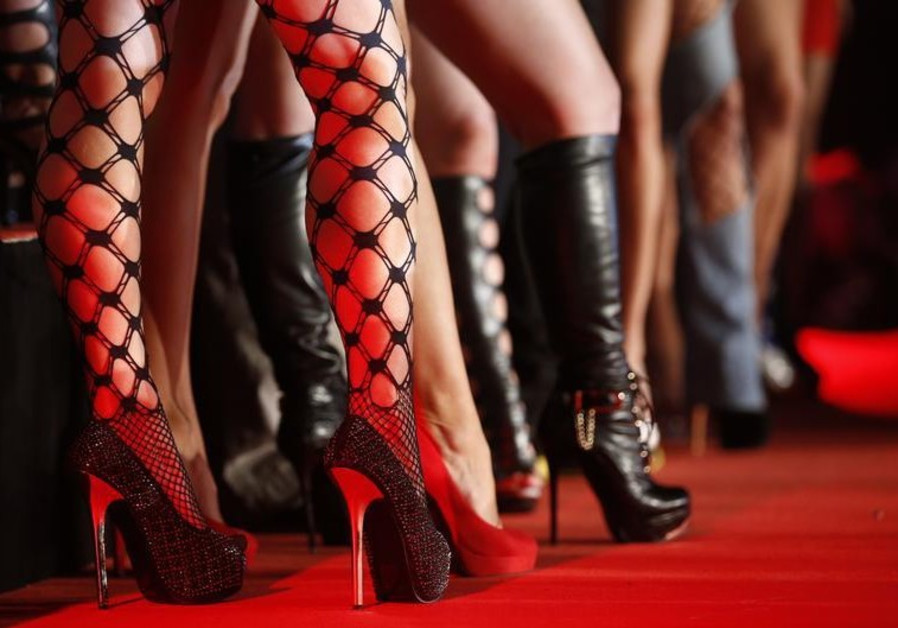 """Porn actresses line-up at the opening of the """"Venus"""" erotic fair in Berlin"""