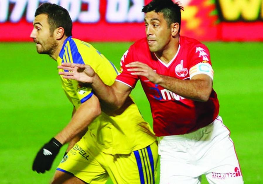 Hapoel Beersheba striker Elyaniv Barda (right) and Maccabi Tel Aviv midfielder Nikola Mitrovic