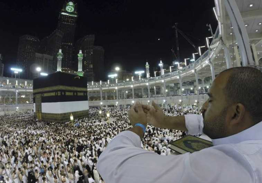 A Muslim pilgrim prays around the holy Kaaba at the Grand Mosque in Mecca