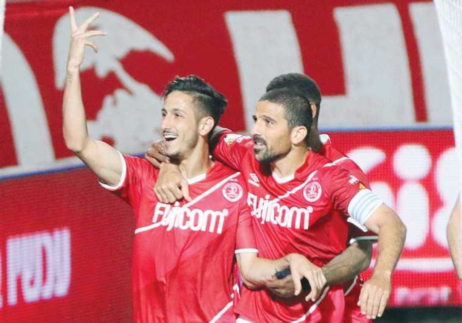 Hapoel Tel Aviv striker Sagiv Yehezkel (left) celebrates with Moshe Ohayon.