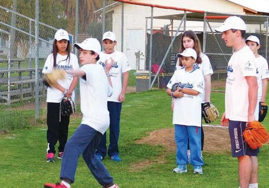 Jewish and Arab youth playing baseball together