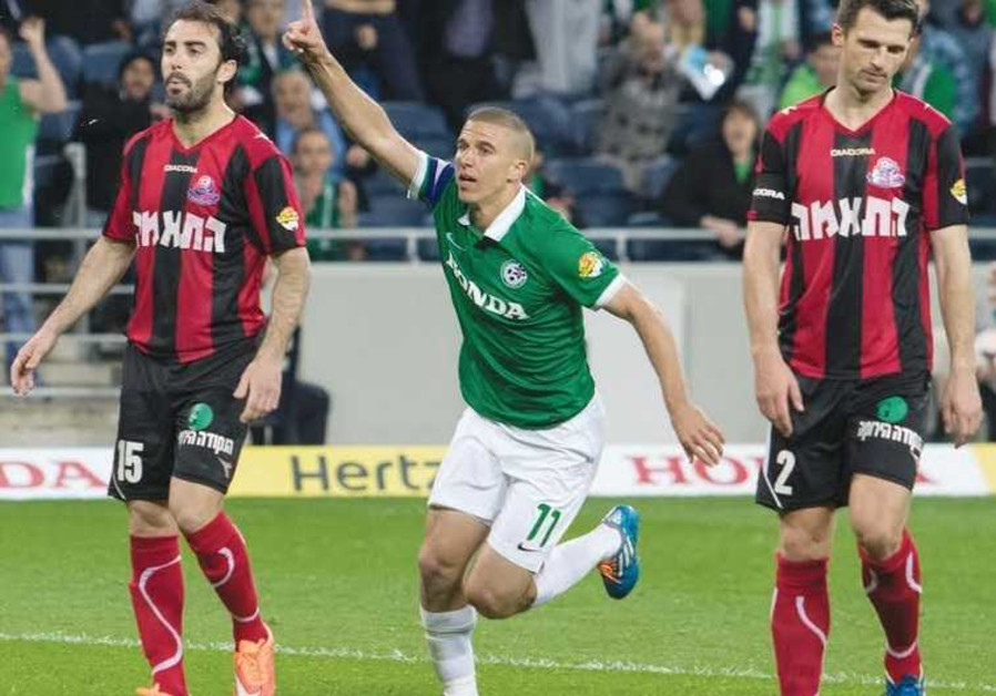 Maccabi Haifa midfielder Idan Vered (center) celebrates after scoring his team's second goal over Ha