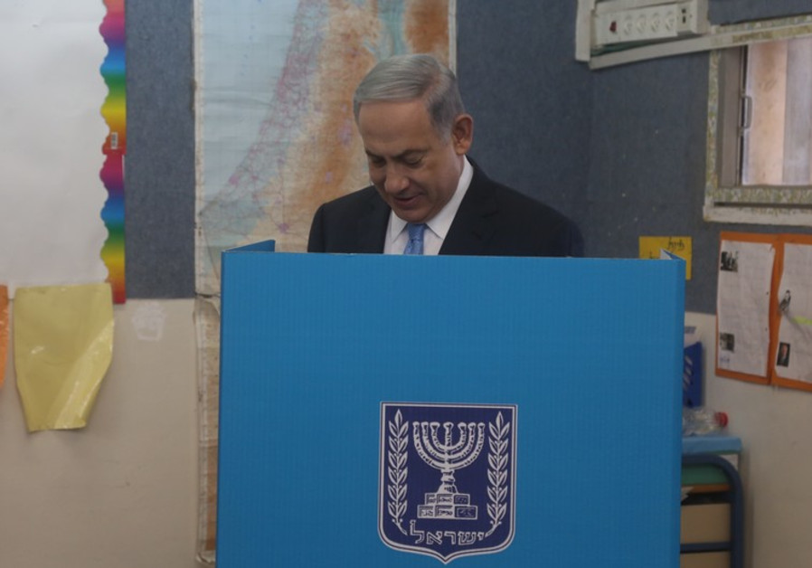 Prime MMinister Benjamin Netanyahu votes in national election, March 17, 2015