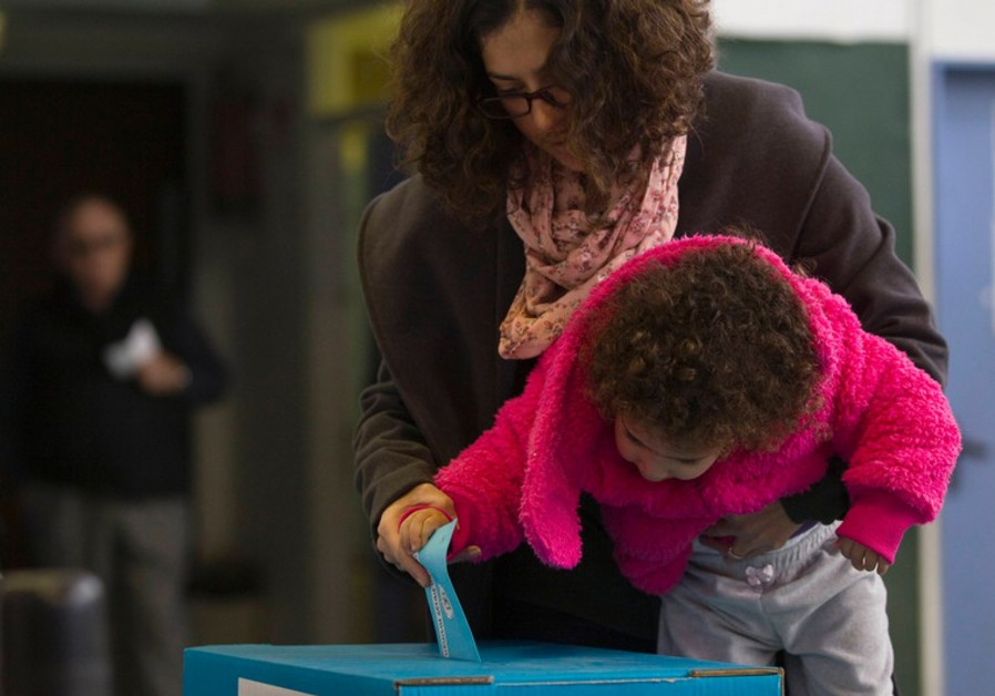 child helps voter