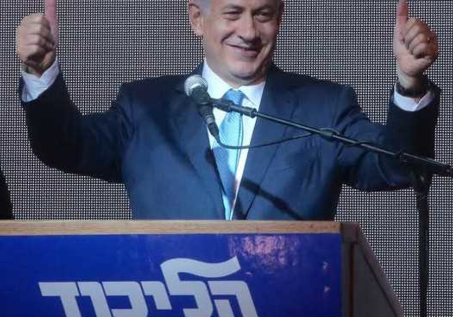 Prime Minister Benjamin Netanyahu gestures during his victory speech at Likud headquarters