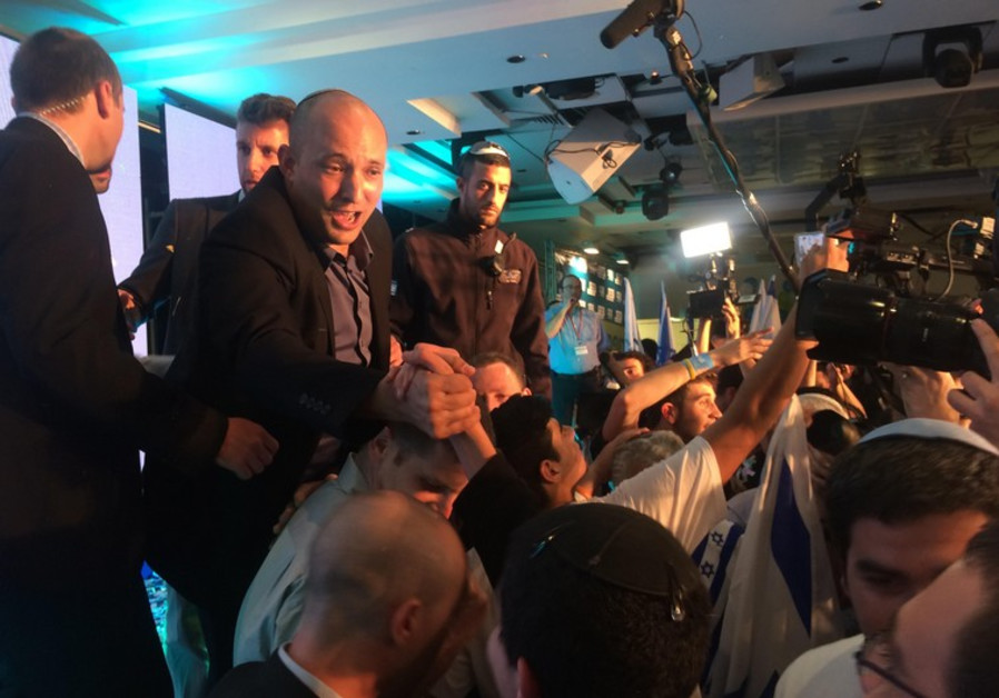 Naftali Bennett greets Bayit Yehudi supporters after the election results were announced